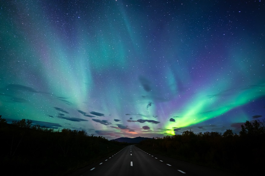 best places to see the northern lights, northern lights in sweden over a highway