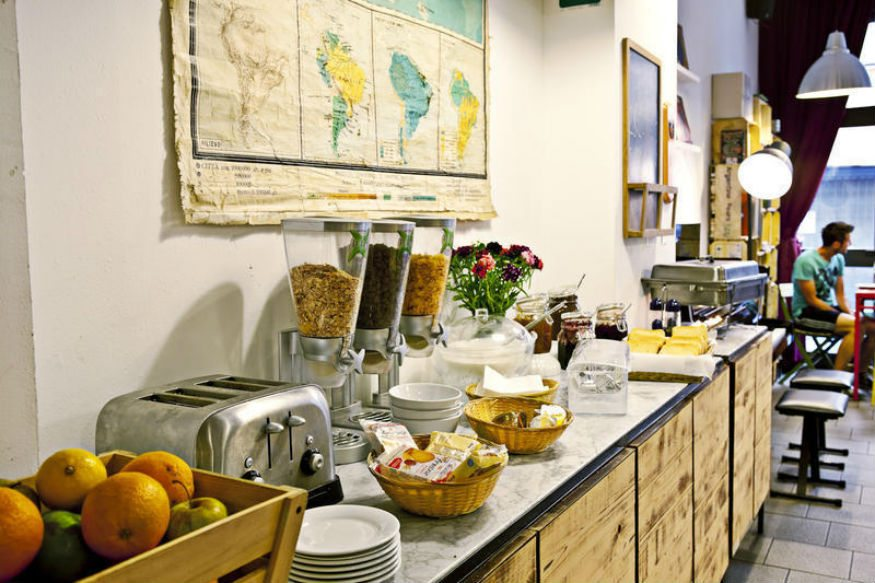 Look for hostels that offer free food to save money
