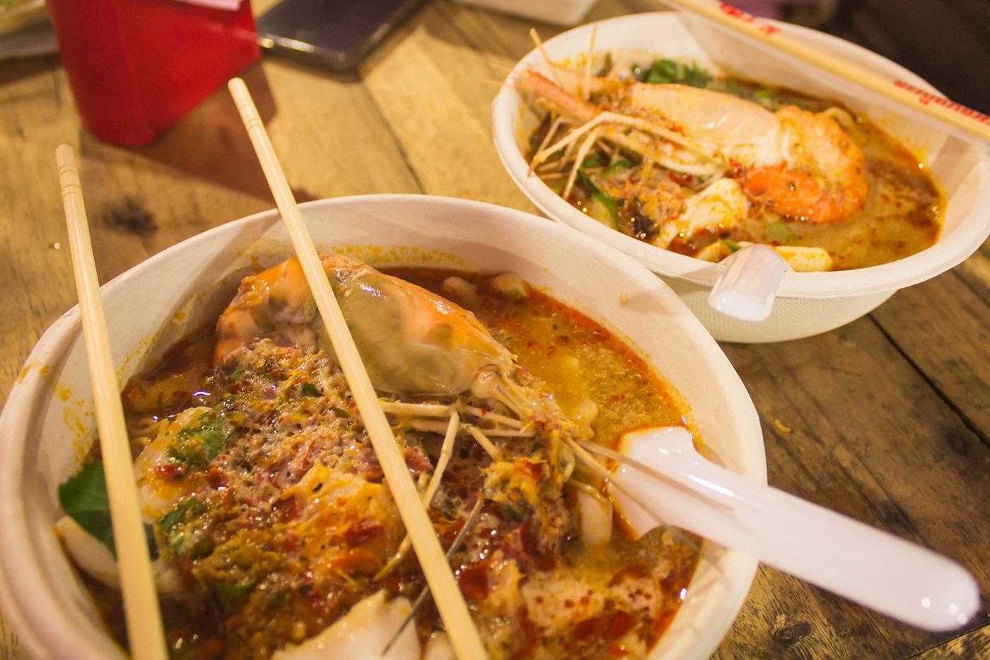 bangkok markets rot fai train market srinakarin night market Tom yum noodle soup with shrimp