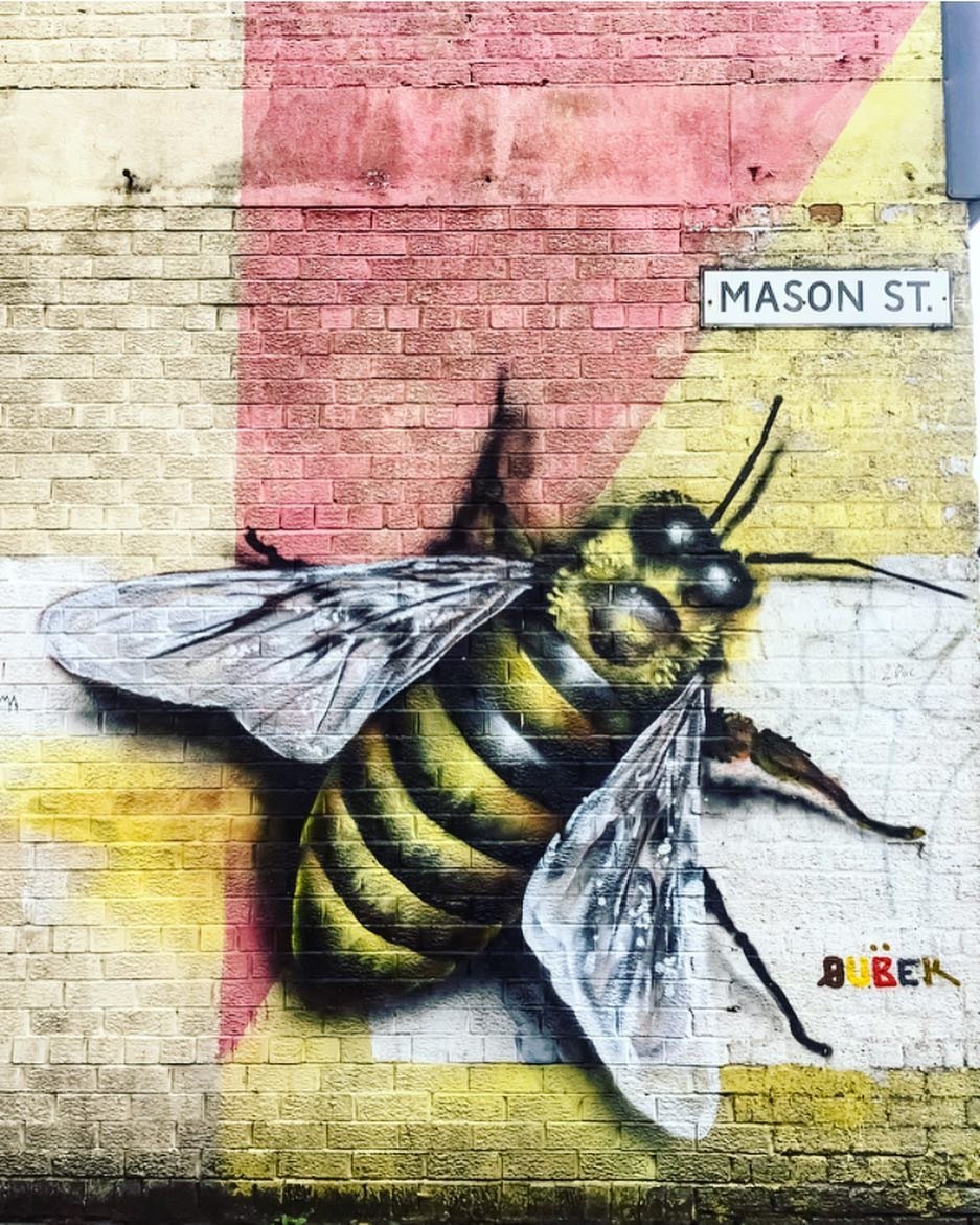Best Places to Visit in England - Street art of a giant bee on a wall in Manchester
