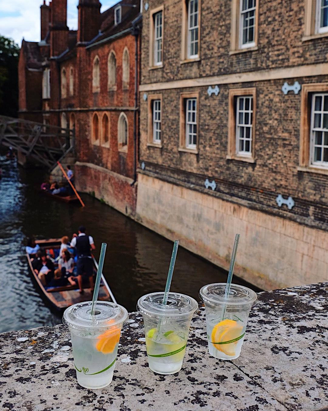 Best Places to Visit in England - Drinking gin and tonic while punting on the canal in Cambridge