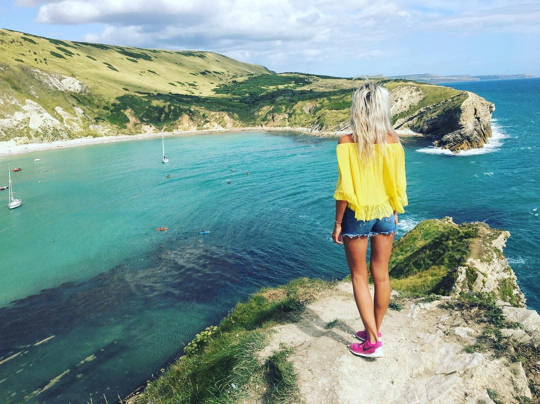 Best Places to Visit in England - Views of cliffs and ocean from West Lulworth Village in Devon