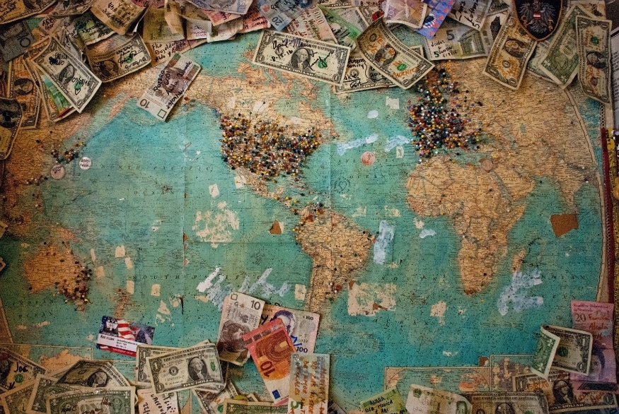 How to save money for travel - map and money
