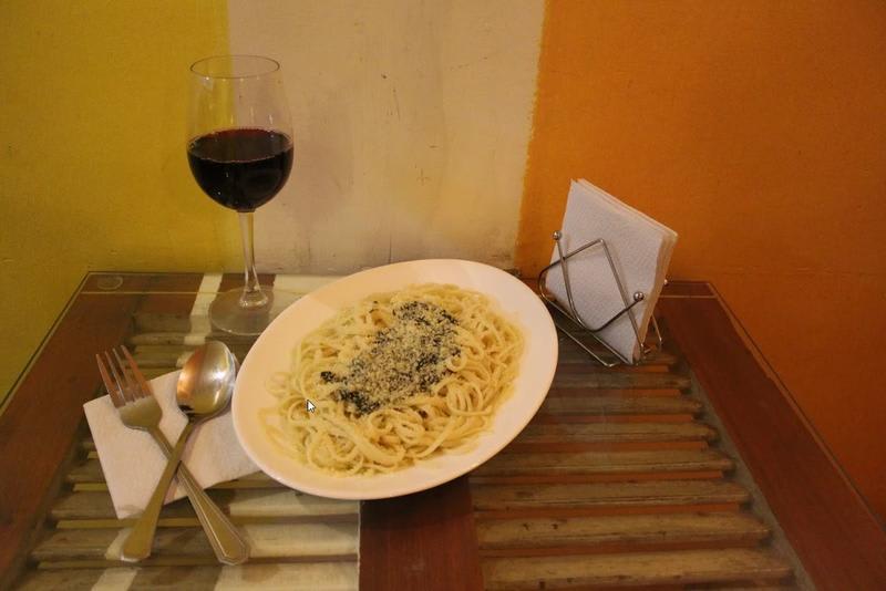 Wine and pasta for meal at Aji Hostel Santiago - Best hostels in Santiago