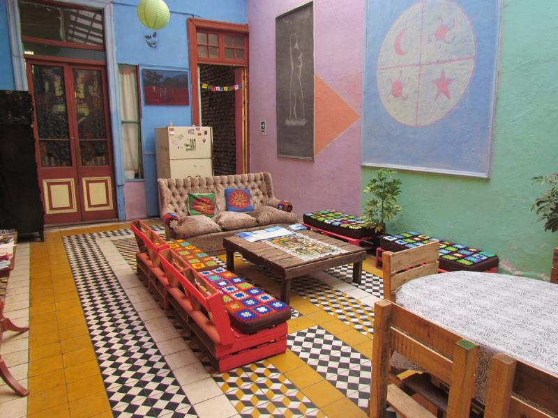 Common space with comfy sofas at Origenes Hostel - Best hostels in Santiago