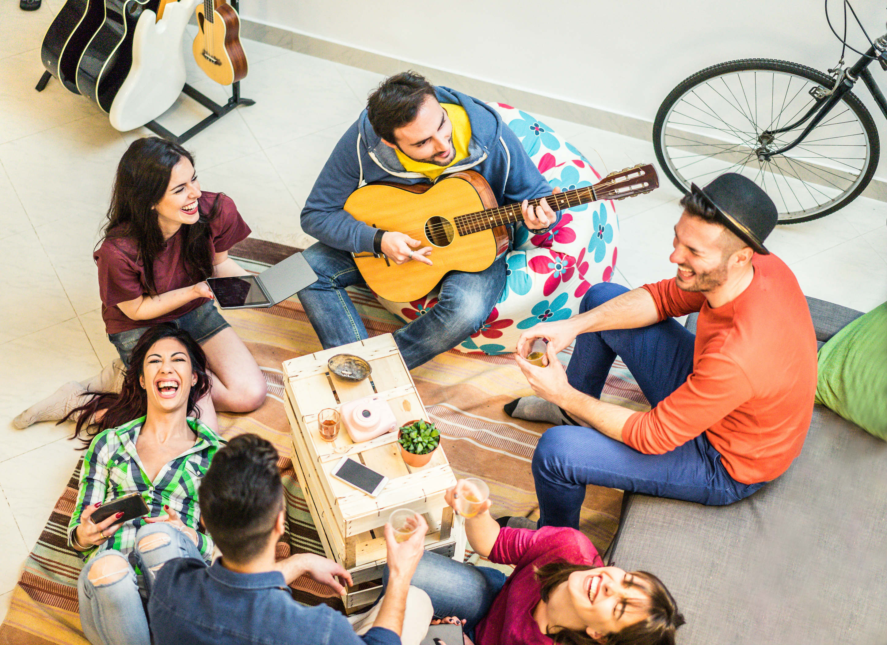 Tips for long term hostel living - group and guitar