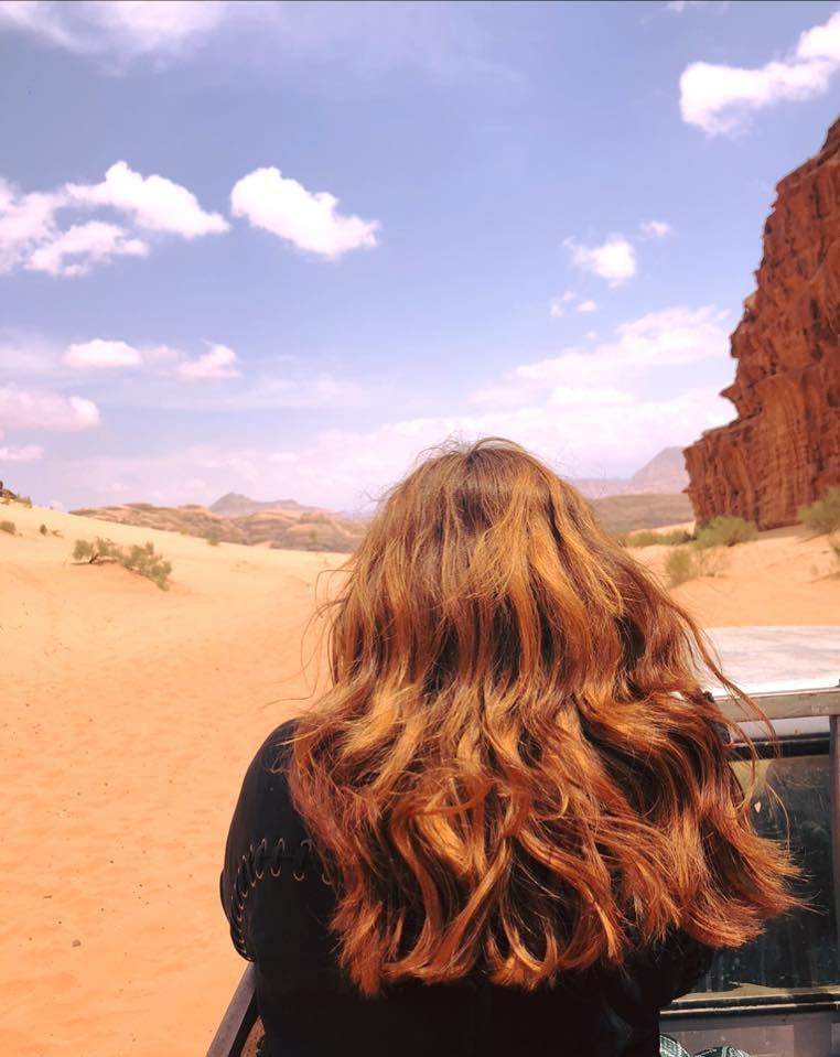 reasons why women travel solo - woman in desert