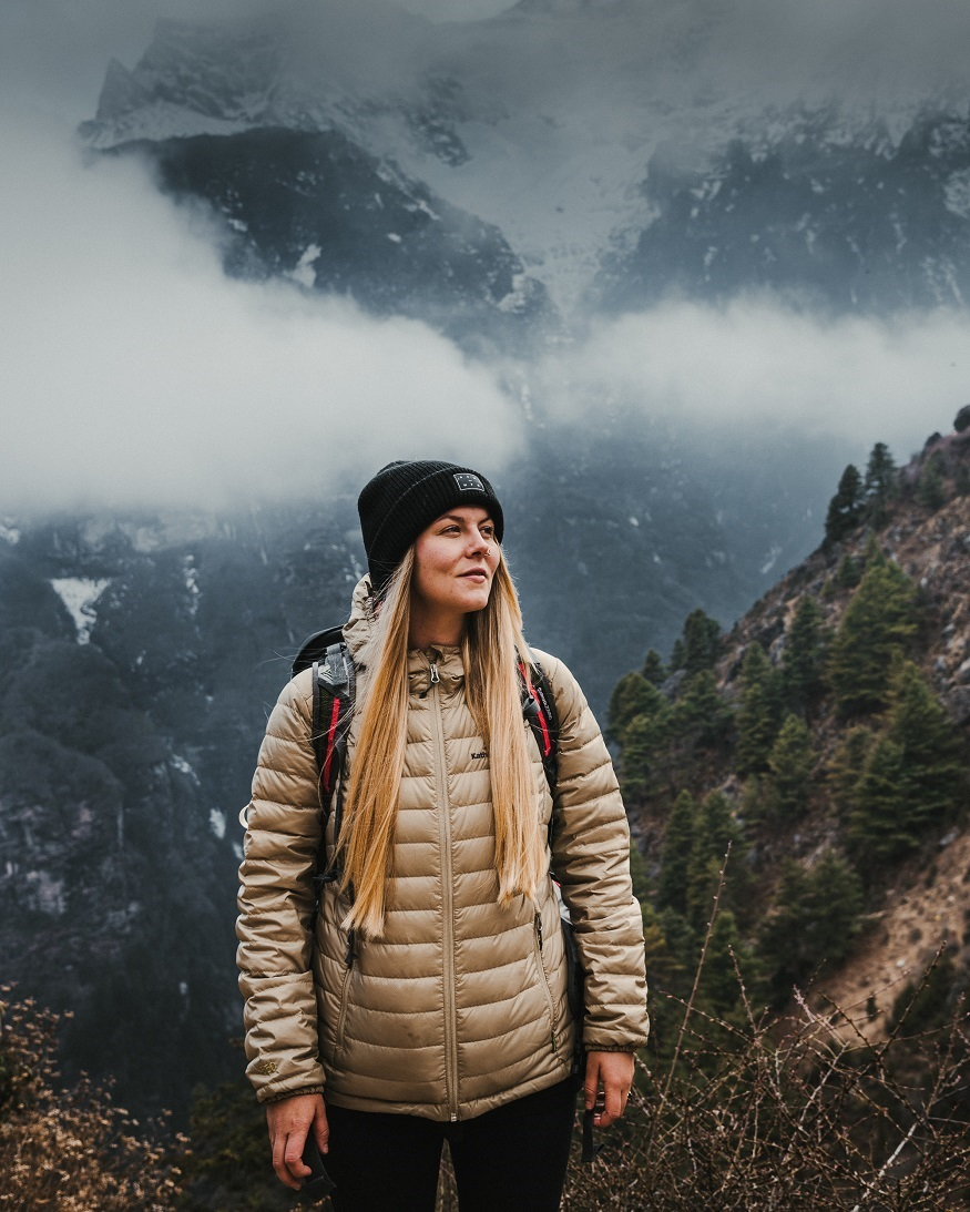 reasons why women travel solo- girl in mountains mist