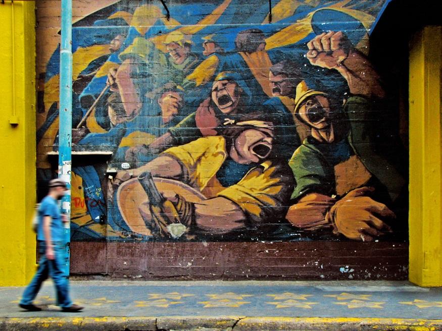 backpacking argentina - man walking past painted wall