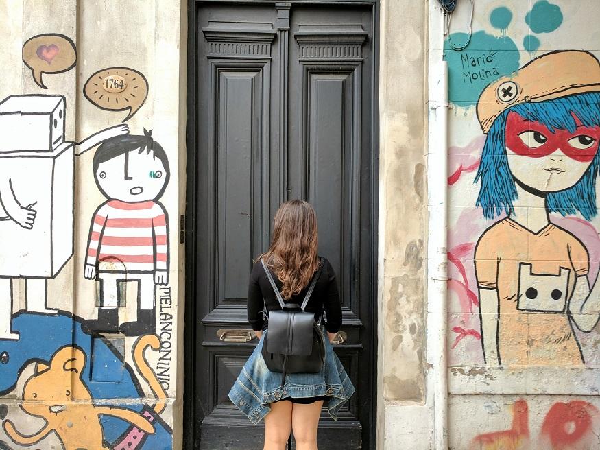 backpacking argentina - girl standing by door