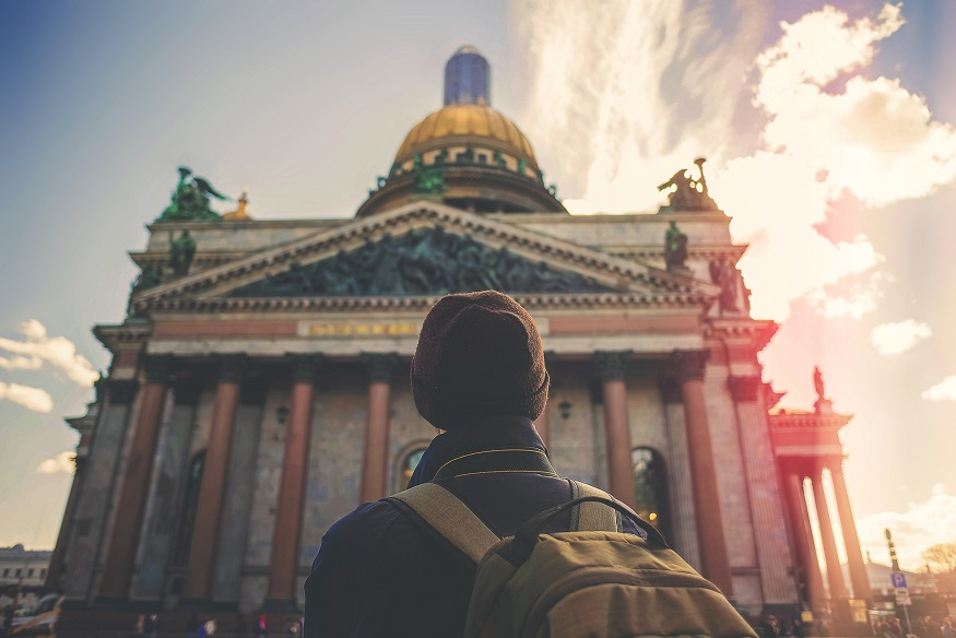 backpacking russia, man standing in front of st. isaacs cathedral, st.-petersburg