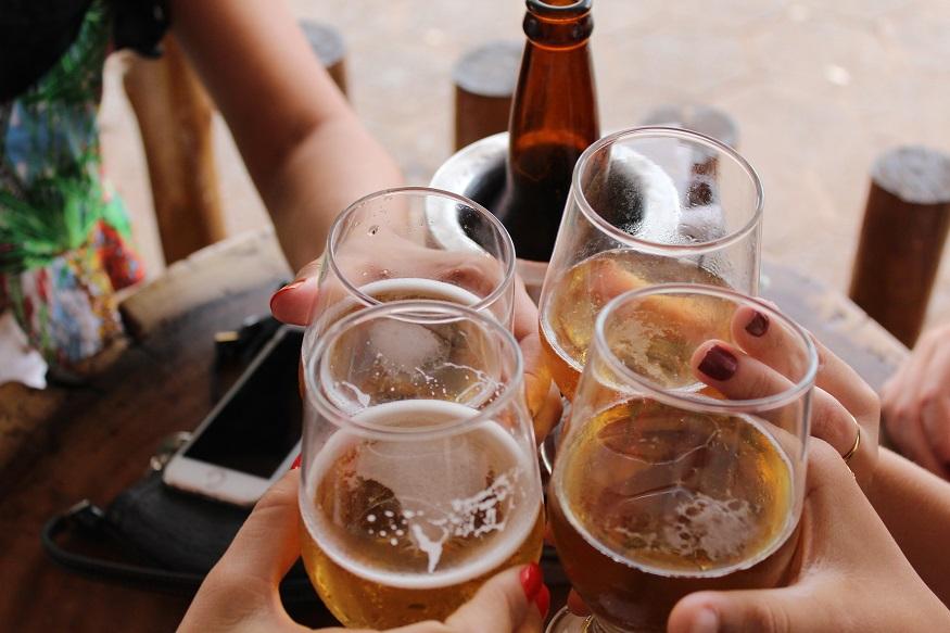 kiev nightlife, a group of people saying cheers with beers