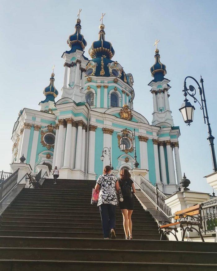 kiev nightlife, two women walking up the steps of saint andrews church