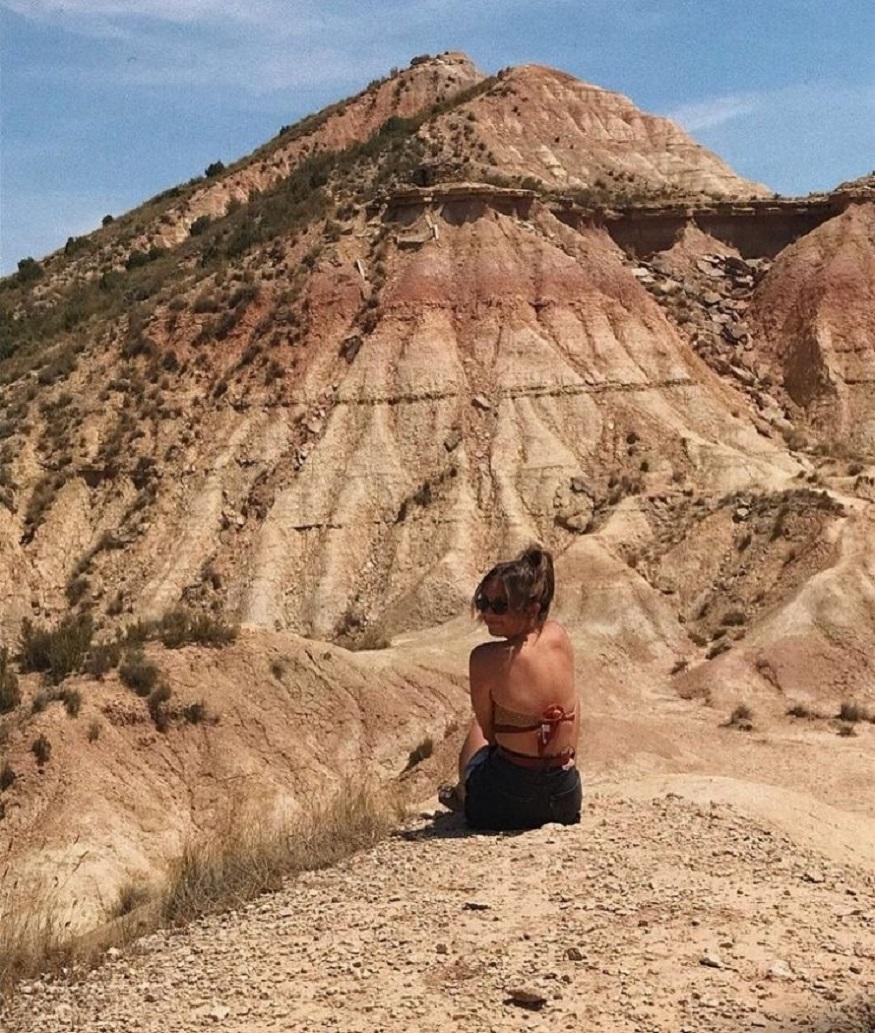best national parks in europe, girl sitting on Castil de Tierra