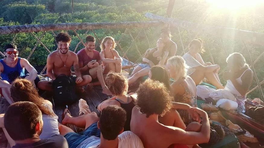 backpacking brazil, people sitting on terrace at Lagarto na Banana hostel