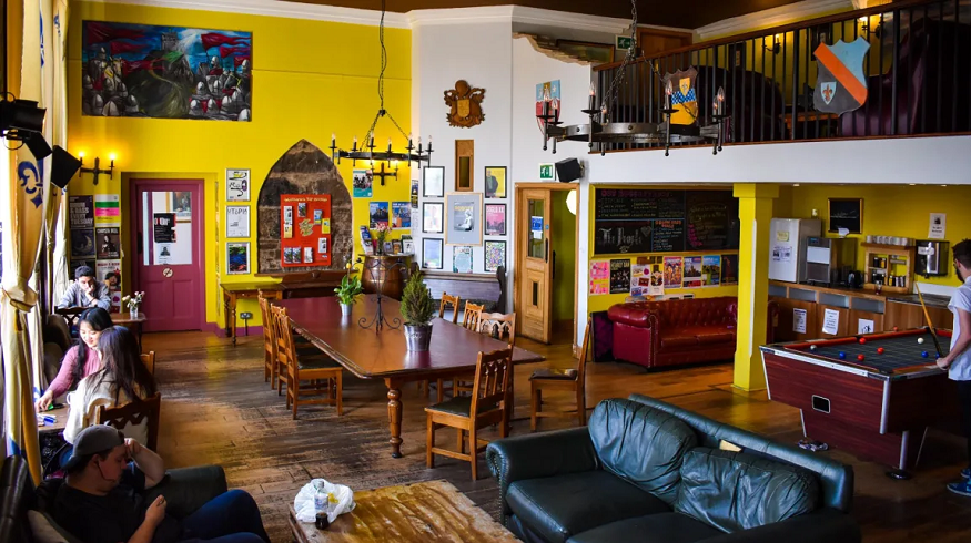 scotland road trip, social area with tables, sofas and pool tables at Castle Rock Hostel
