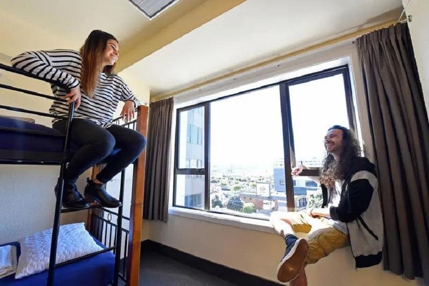 eco-friendly hostels, girls in dorm room in YHA Wellington City