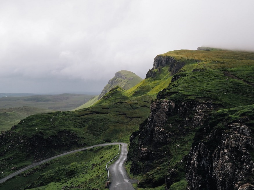 scotland road trip, road in the mountains in quiraing, portree