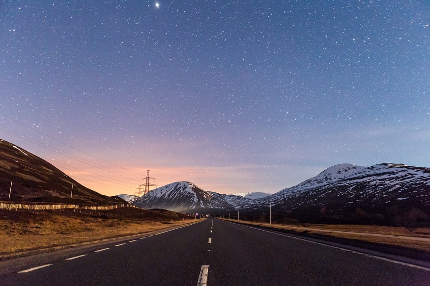 scotland road trip, road through Pitlochry with a starry sky