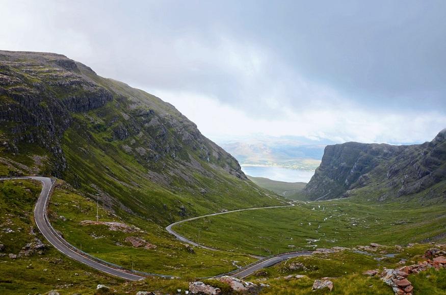scotland road trip, road through mountains in skye