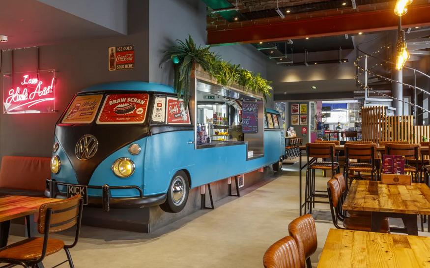 scotland road trip, inside Kick Ass Greyfriars hostel social area with vw campervan bar