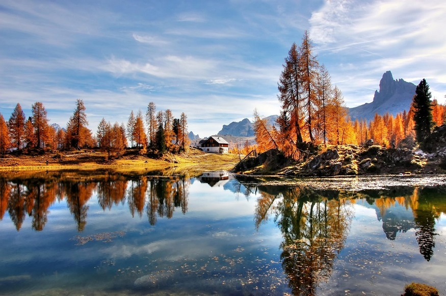 best national parks in europe,lake in autumn in the dolomites belluno national park