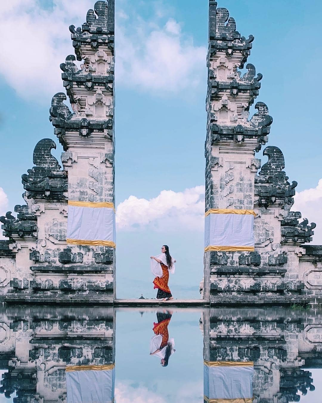 how to avoid overtourism, girl standing at heaven's gate in bali