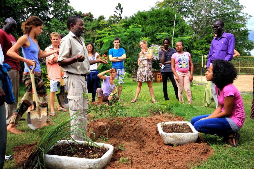 best independent hostels, people gardening at Distant Relatives hostel, Kilifi, Kenya