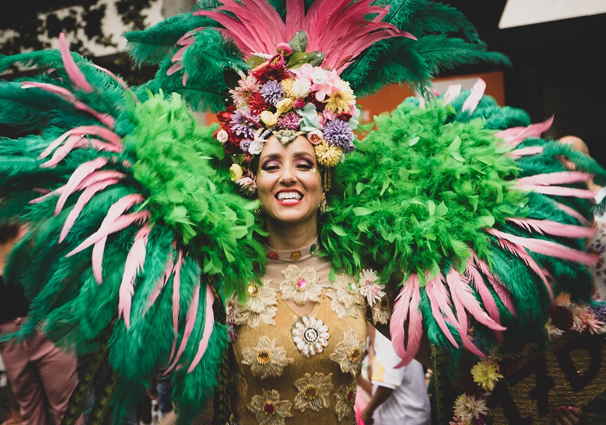 things to do in South America - woman in carnival outfit with feathers