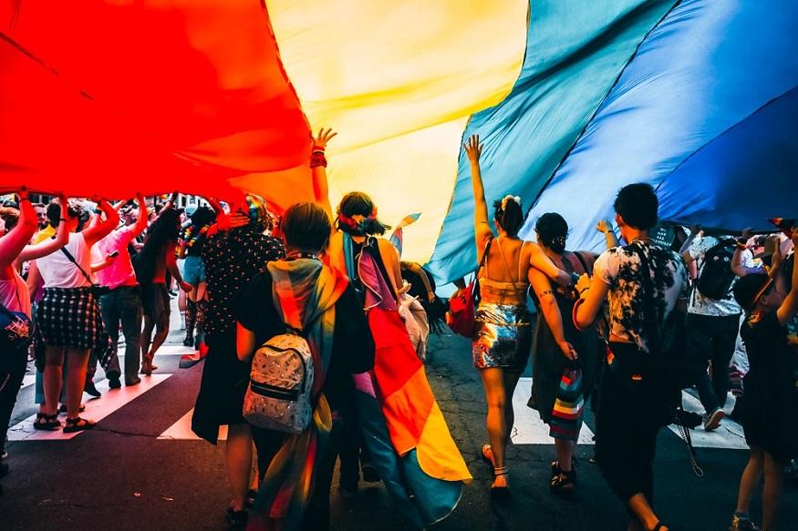 Berlin LGBT nightlife - people walking under a rainbow flag at pride