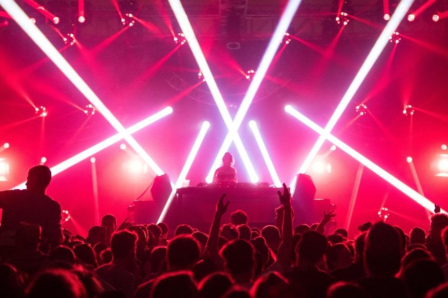 Berlin LGBT nightlife - dj in a nightclub with red lasers