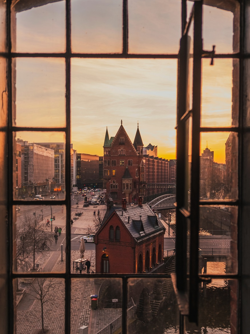 underrated european cities - sunset view over hamburg from a window
