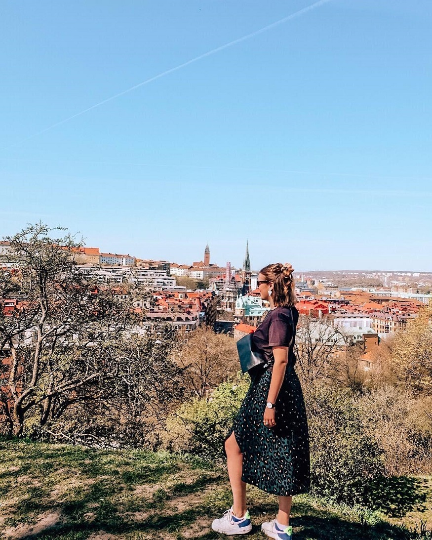 underrated european cities - girl standing on hill in gothenburg