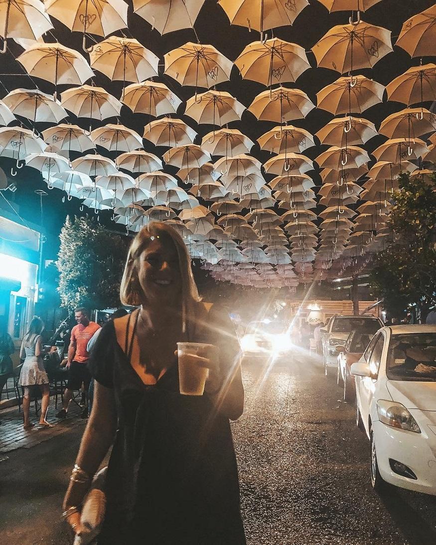 best backpacker parties, girl with a beer at La Placita de Santurce – San Juan, Puerto Rico