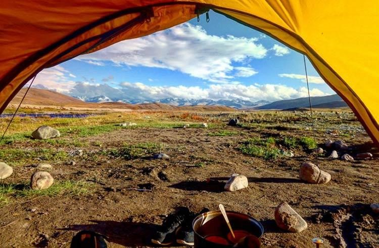 from backpacker to hostel owner -view of mountain and landscapes from inside a tent