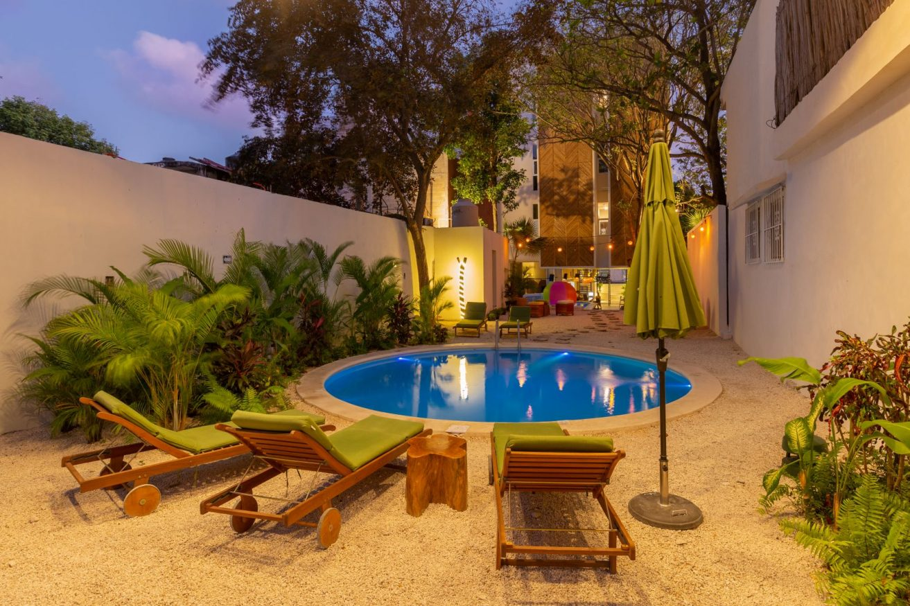 sun loungers by the pool at oostel smart hostel, mexico nominated for extraordinary new hostel award